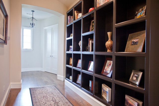 Example of a mid-sized tuscan medium tone wood floor and brown floor hallway design in Other with beige walls