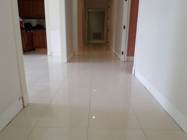 Polished porcelain 24 x24 tile with a 1 8 grout line for Tiled hallway floor ideas