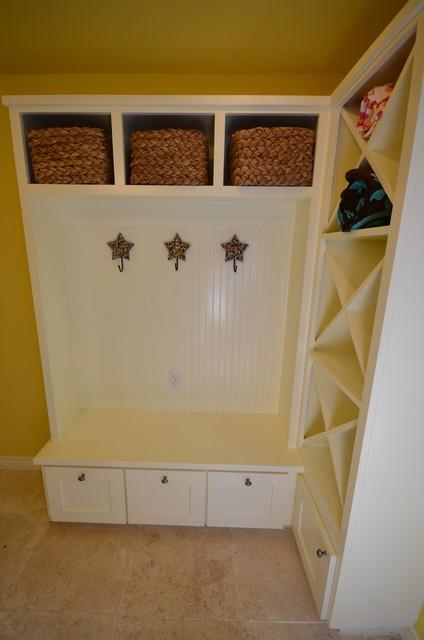 Hallway - mid-sized traditional travertine floor and beige floor hallway idea in Austin with yellow walls