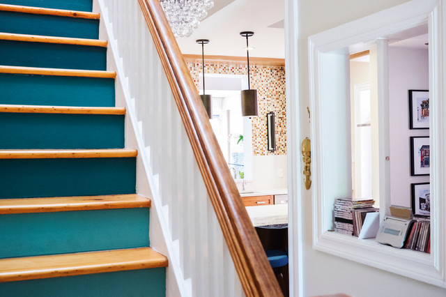 Inspiration for a mid-sized contemporary hallway remodel in Toronto with white walls