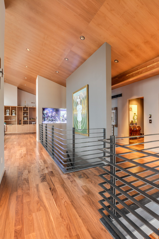 Mid-sized minimalist medium tone wood floor hallway photo in Seattle with multicolored walls