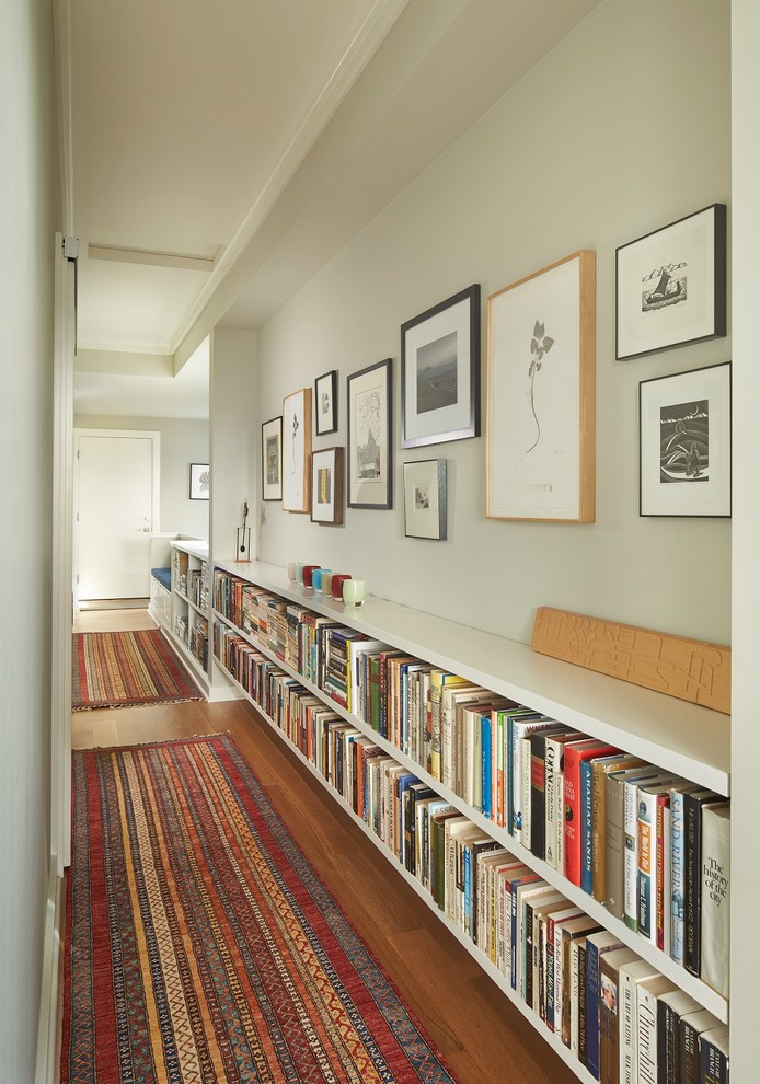 Small transitional medium tone wood floor hallway photo in Seattle with white walls