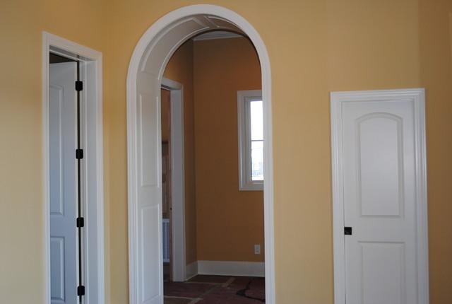 Raised Panel Arch Way traditional-hall