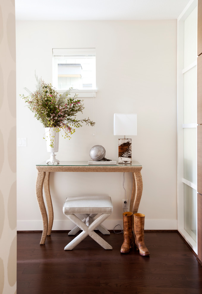 Example of an eclectic dark wood floor hallway design in Vancouver with white walls