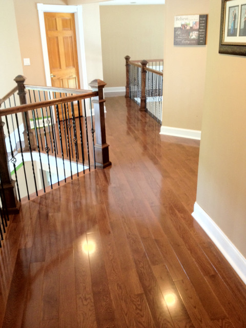 Red oak with warm walnut stain traditional hall for Traditional flooring
