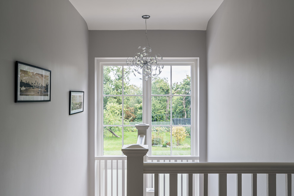 Inspiration for a mid-sized timeless hallway remodel in Surrey with gray walls