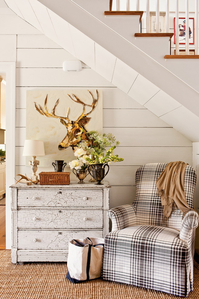 Cottage chic hallway photo in Atlanta with white walls