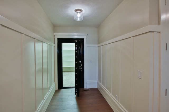 Inspiration for a large transitional medium tone wood floor hallway remodel in Salt Lake City with white walls