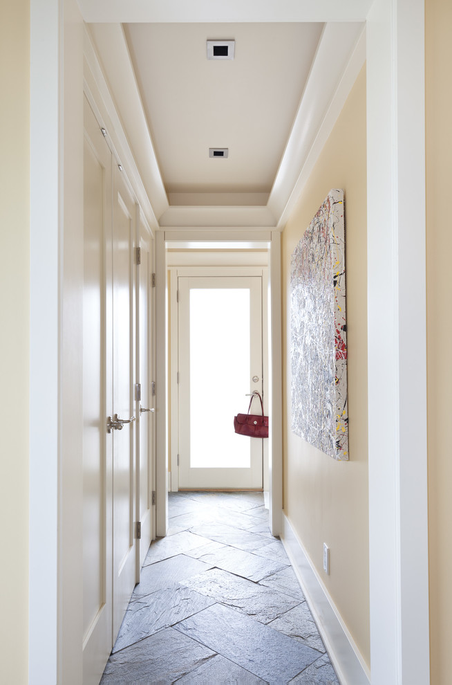 Hallway - mid-sized transitional slate floor hallway idea in Vancouver with yellow walls