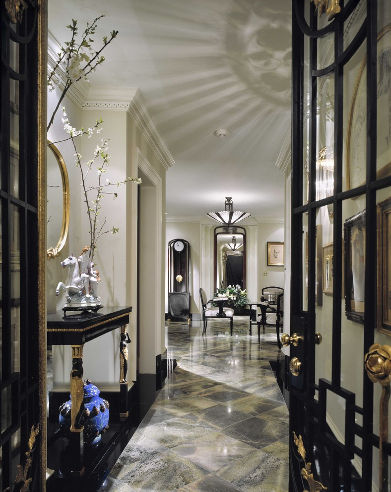 Example of a classic multicolored floor hallway design in Houston with beige walls