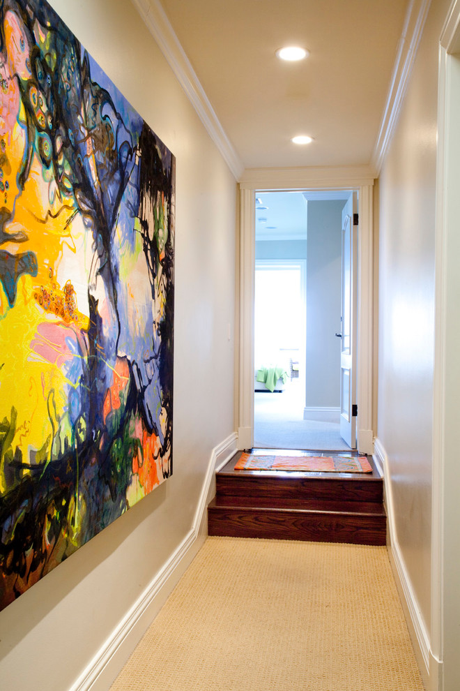 Trendy carpeted hallway photo in Los Angeles with beige walls