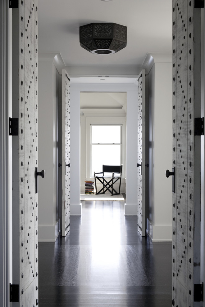 Inspiration for a transitional black floor hallway remodel in Boston with white walls