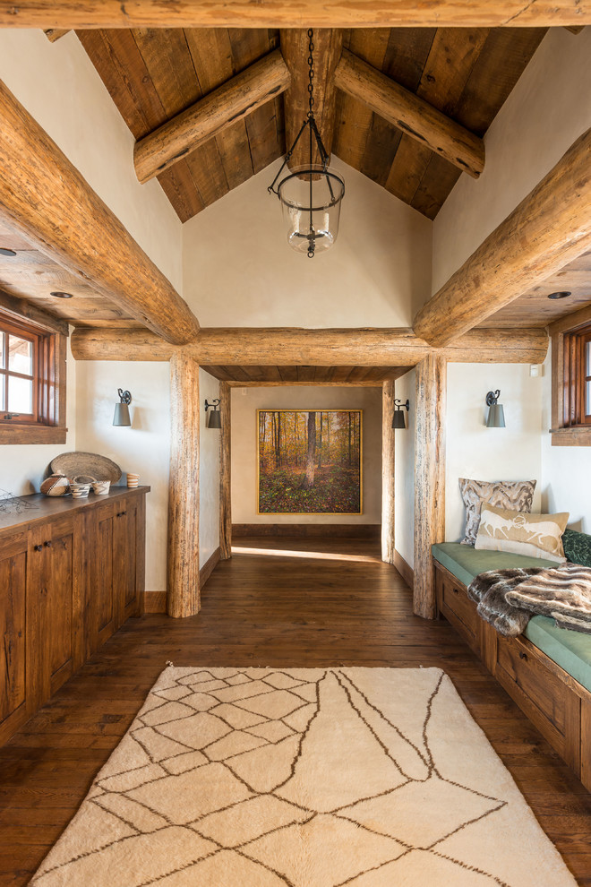 Mountain style dark wood floor hallway photo in Other with white walls