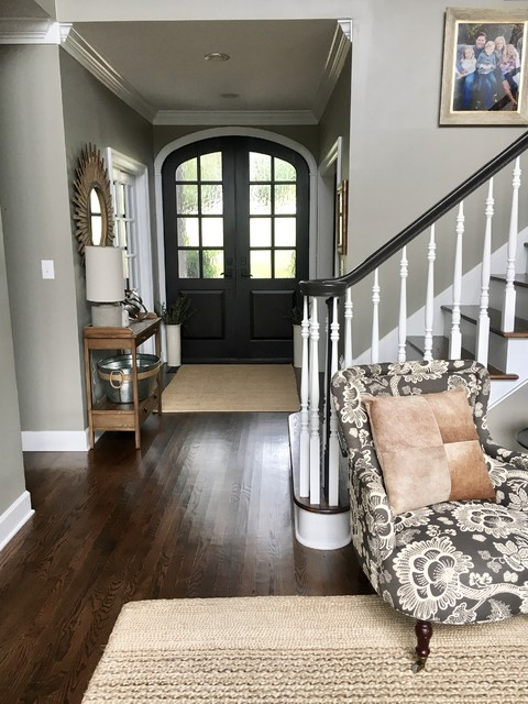 Inspiration for a mid-sized rustic dark wood floor and brown floor hallway remodel with gray walls