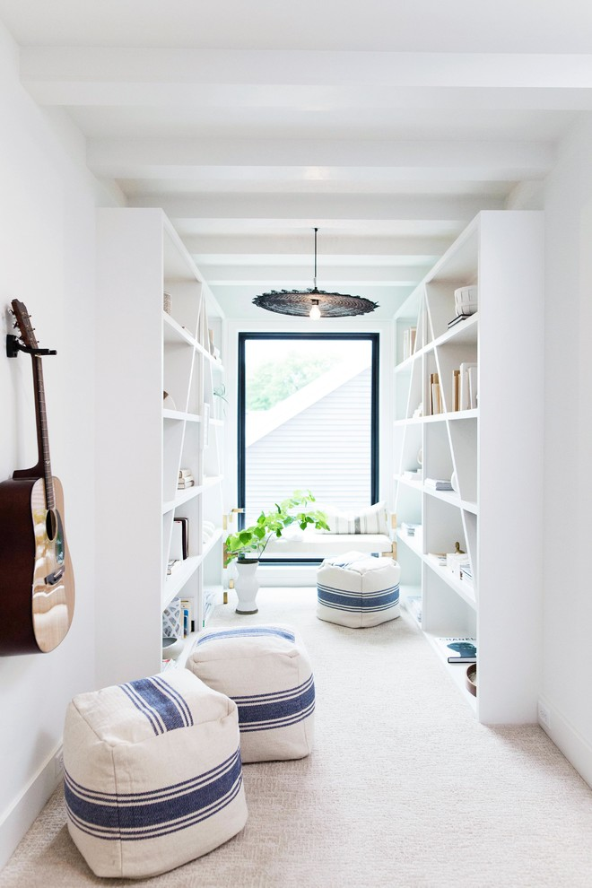 Example of a danish carpeted and beige floor hallway design in Grand Rapids with white walls