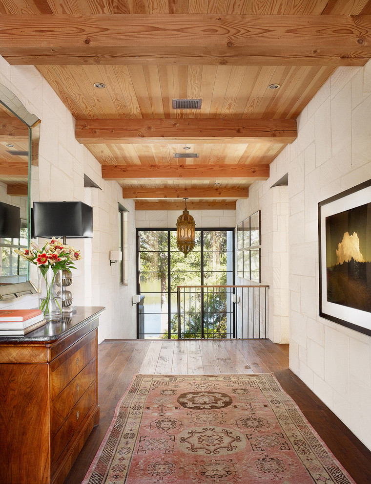 Inspiration for a contemporary dark wood floor hallway remodel in Austin with white walls