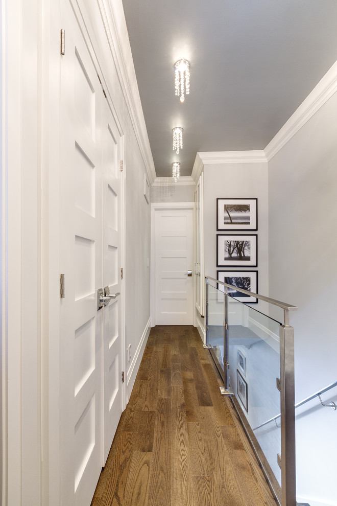 Hallway - small contemporary medium tone wood floor hallway idea in Other with gray walls