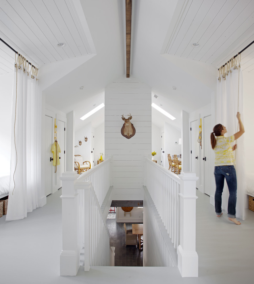 Inspiration for a mid-sized coastal hallway remodel in Atlanta with white walls
