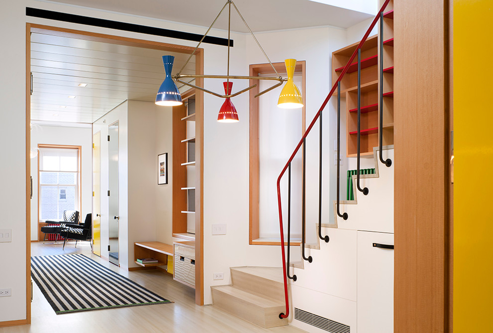 Inspiration for a contemporary hallway remodel in New York with white walls