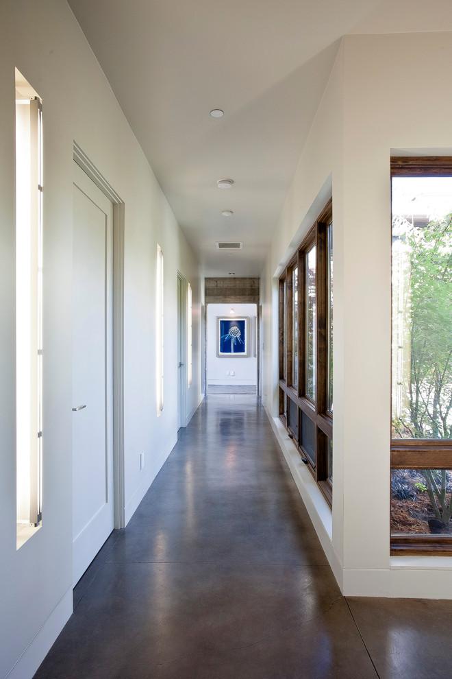 Example of a minimalist concrete floor and gray floor hallway design in San Francisco