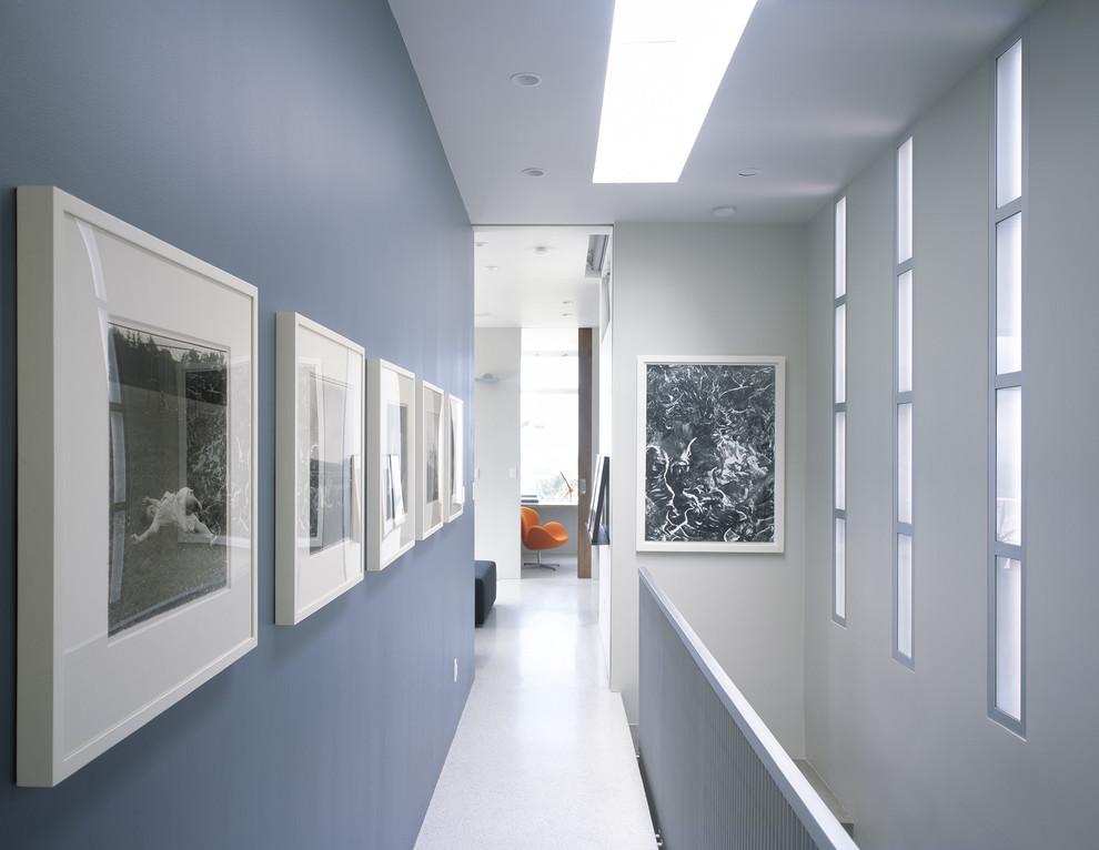 Hallway - contemporary white floor hallway idea in San Francisco with blue walls