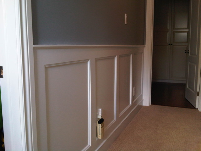 Stairway with wall paneling traditional-hall