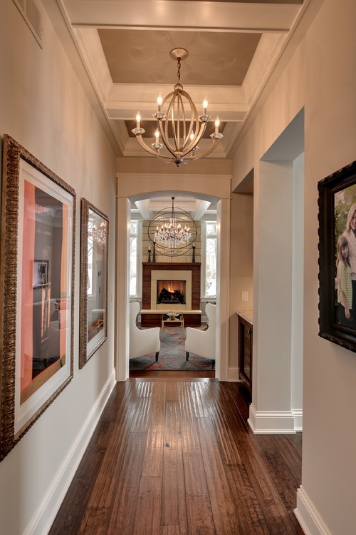 love the hallway chandeliers mix of wood with modern do