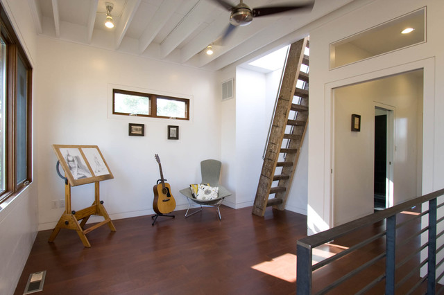 example of a trendy hallway design in with white walls