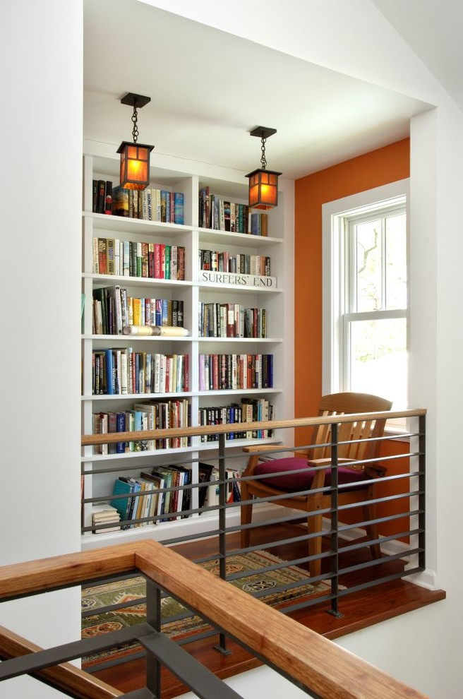 Inspiration for a mid-sized craftsman medium tone wood floor and brown floor hallway remodel in New York with orange walls