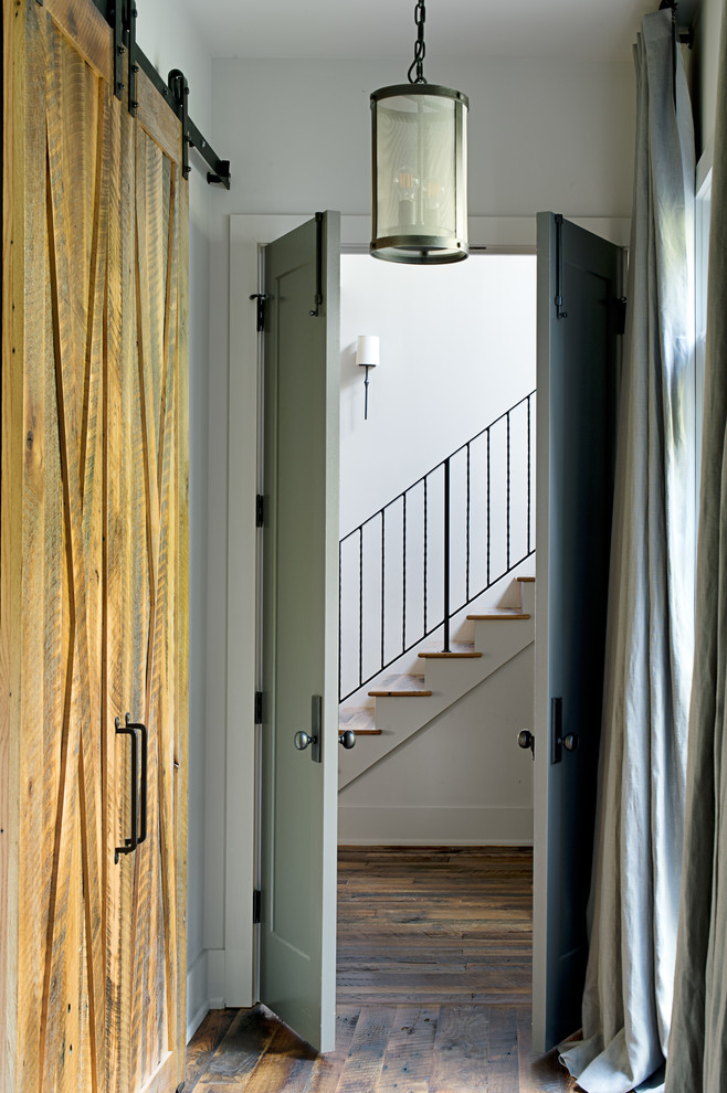 Example of a mid-sized transitional medium tone wood floor and brown floor hallway design in Other with white walls
