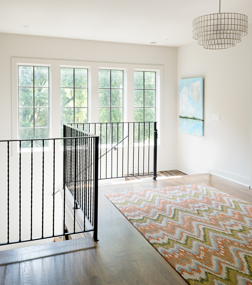 Example of a mid-sized transitional dark wood floor hallway design in Nashville with white walls