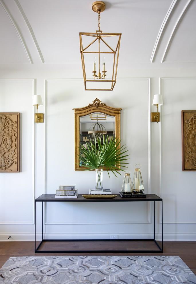 Transitional medium tone wood floor hallway photo in Jacksonville with white walls