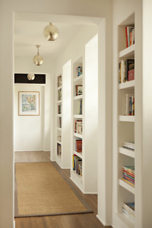 hallway with built-in bookshelves