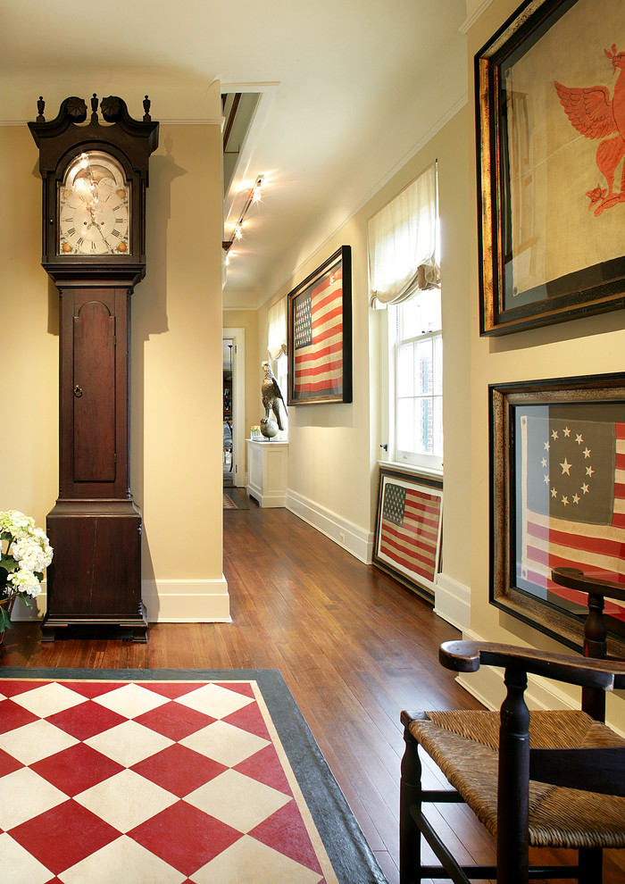 Inspiration for a mid-sized rustic dark wood floor and brown floor hallway remodel in Newark with beige walls