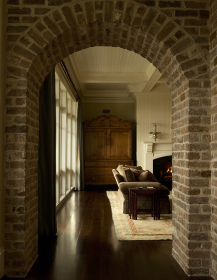 Brick Arched Opening into Living Room traditional-hall