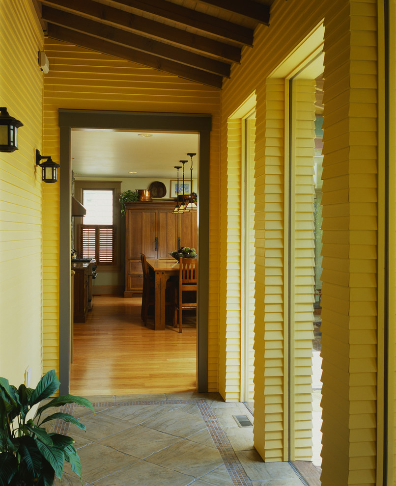 Example of an arts and crafts hallway design in DC Metro with yellow walls