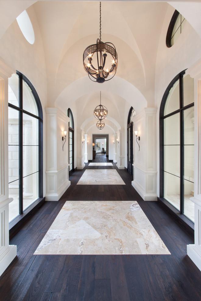 Huge elegant dark wood floor and multicolored floor hallway photo in Orlando with white walls