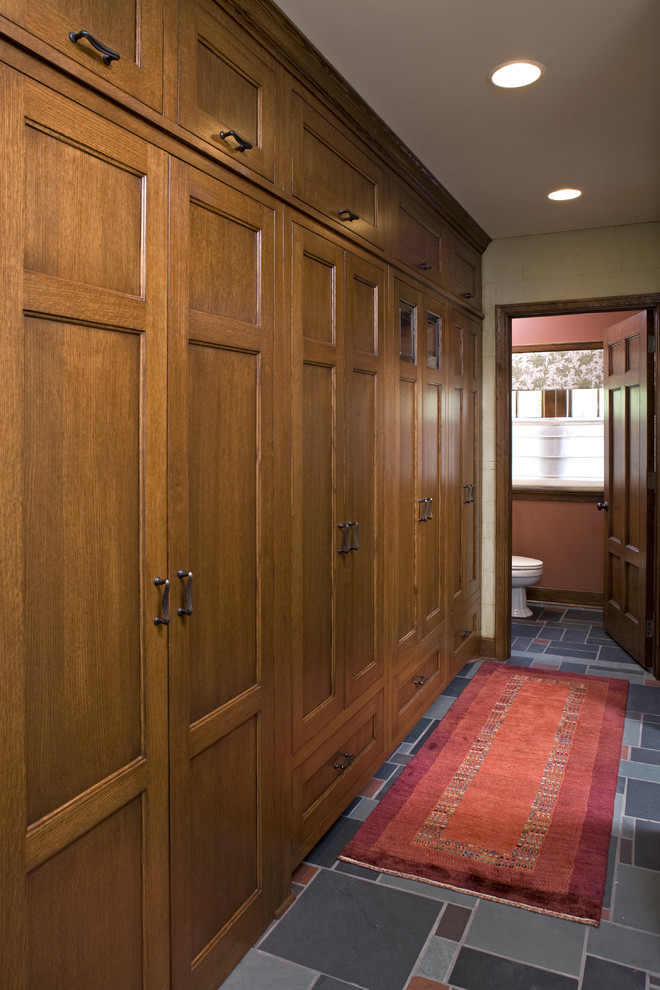 Example of a classic multicolored floor hallway design in Minneapolis with beige walls