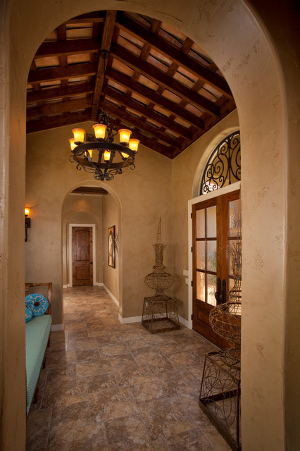 Tuscan style home by jim boles custom homes for Wall design in hall