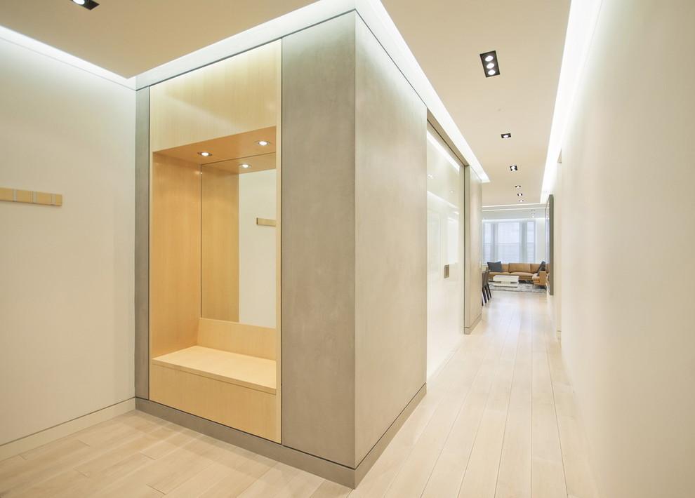 Minimalist light wood floor hallway photo in New York with white walls