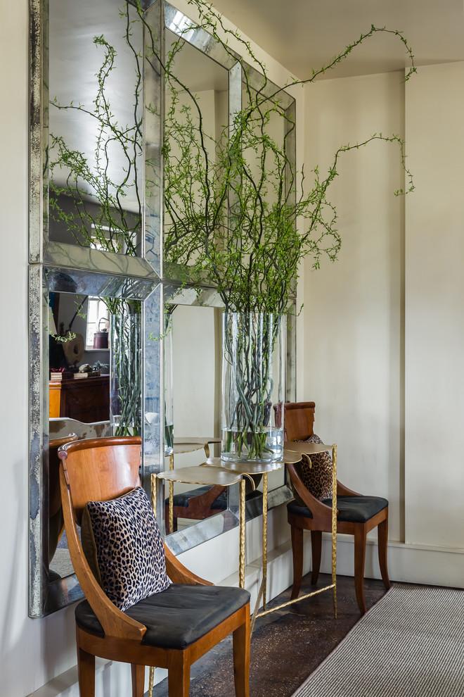 Hallway - small eclectic concrete floor hallway idea in Raleigh with beige walls