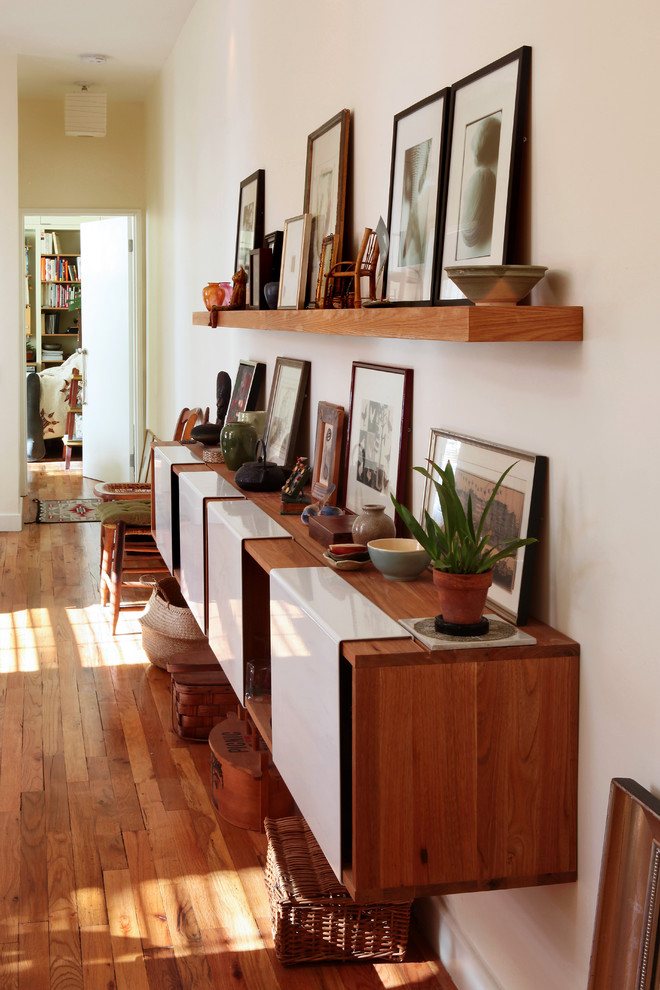 Inspiration for an eclectic hallway remodel in New York with white walls