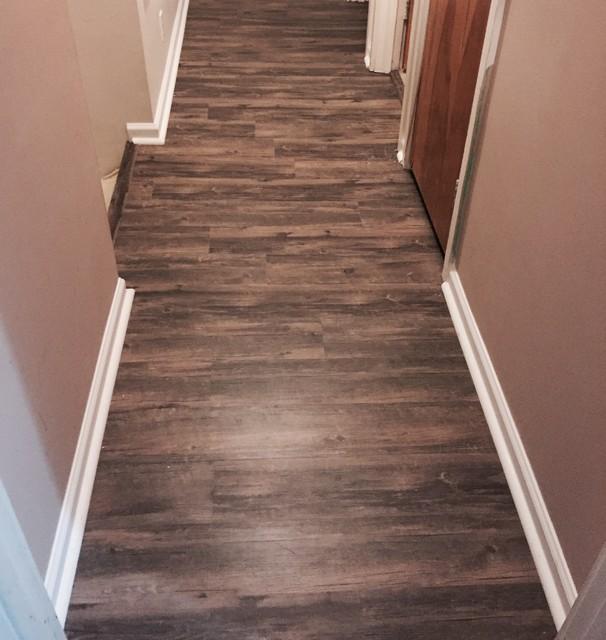 Vinyl plank flooring and trim quarter round installed for Floor quarter round