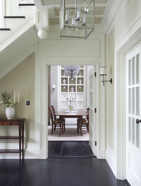 Inspiration for a timeless black floor hallway remodel in Dublin with beige walls
