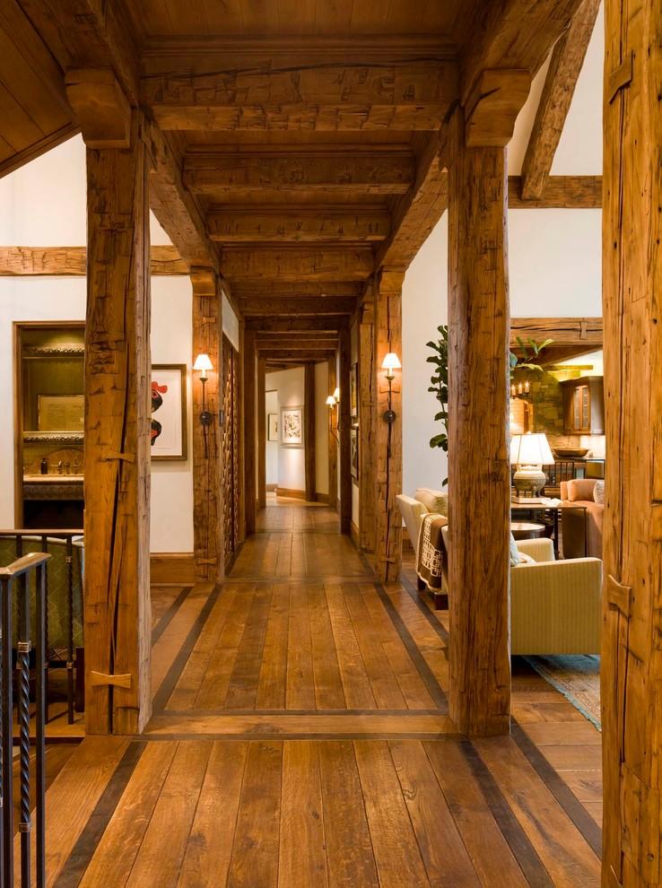 Inspiration for a huge rustic dark wood floor hallway remodel in Denver with white walls