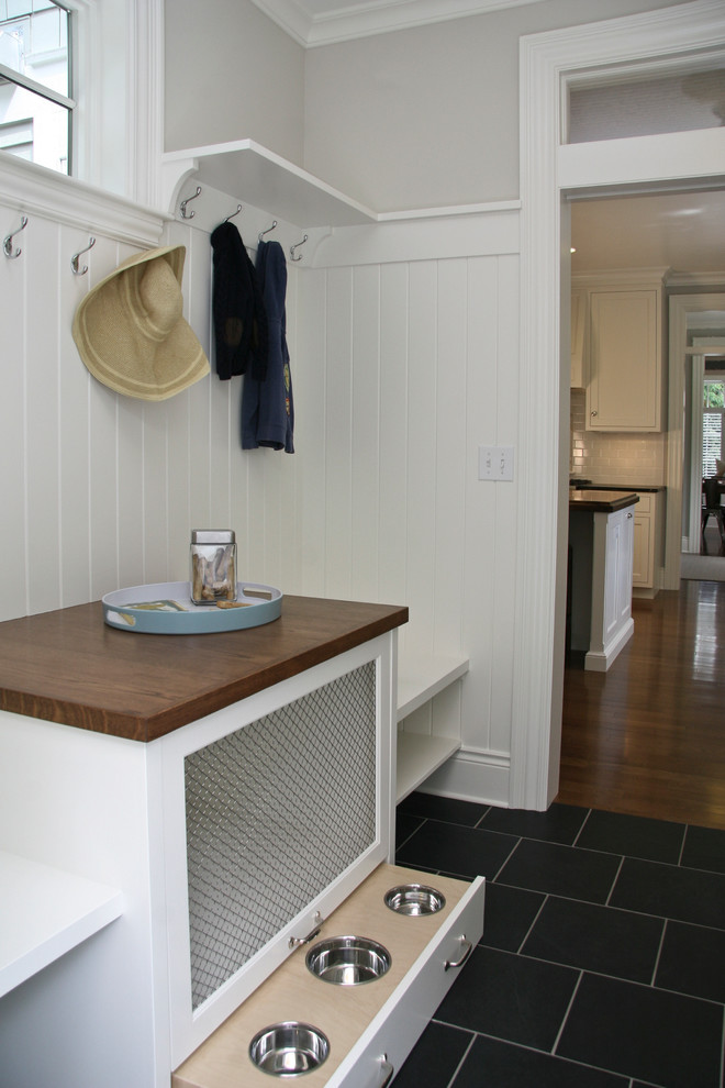 Example of a mid-sized transitional slate floor hallway design in Grand Rapids with white walls