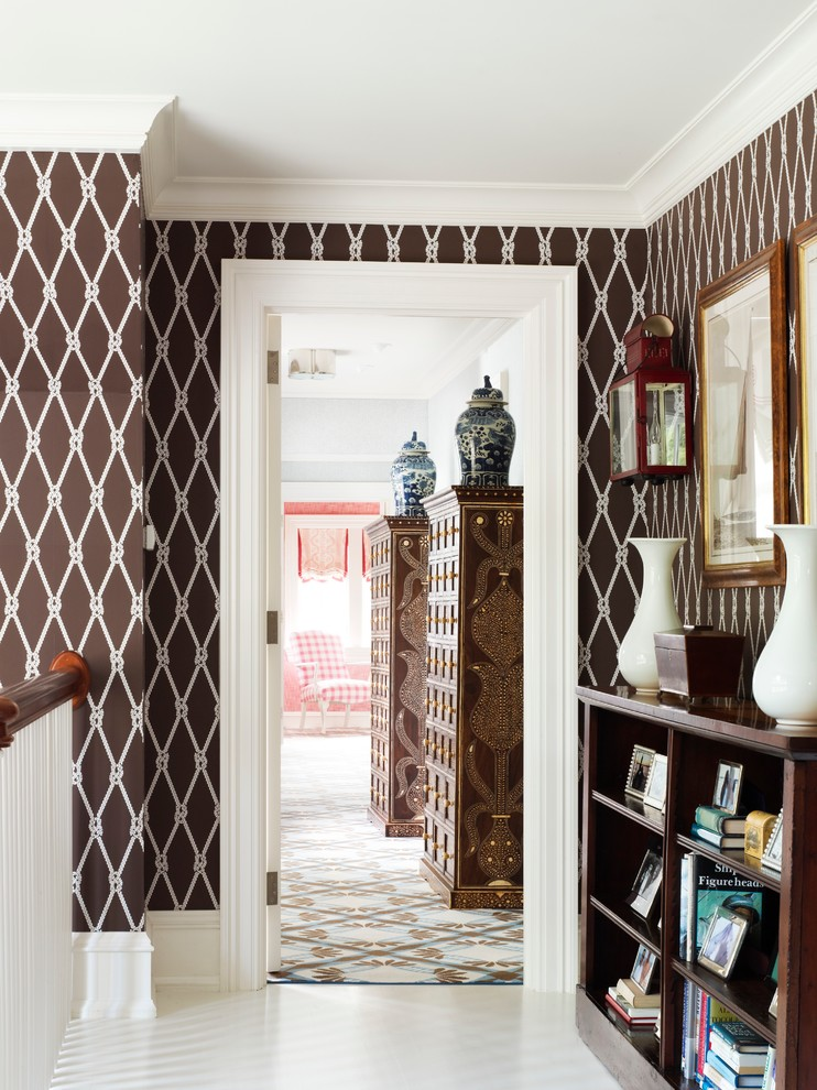 Example of a coastal hallway design in New York with multicolored walls