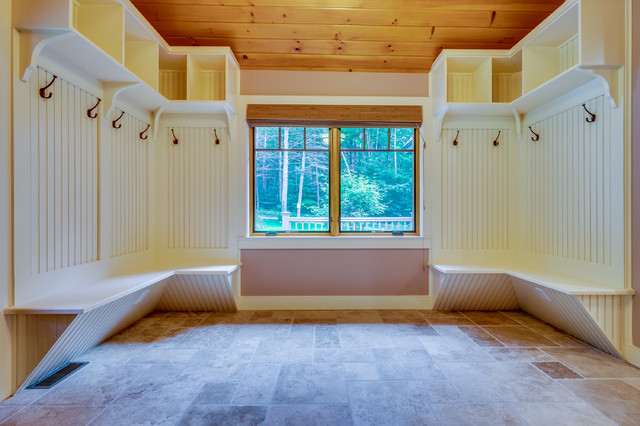 Example of a large trendy ceramic floor hallway design in Boston with white walls