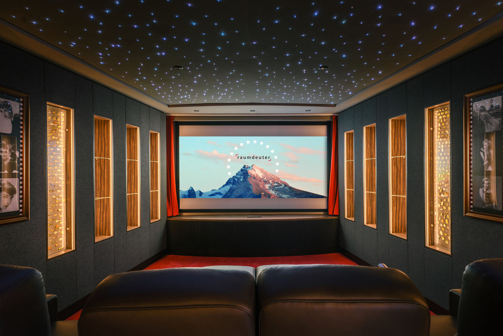 Large trendy carpeted and red floor home theater photo in Berlin with gray walls and a projector screen