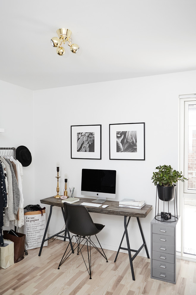 Inspiration for a scandinavian freestanding desk light wood floor home office remodel in Wiltshire with white walls and no fireplace